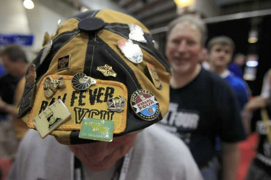 Virginia Commonwealth fan Doug Floyd of Mechanicsville, Va., show off his Final Four pin collection before the first half of the NCAA National Semifinals  on Saturday. Photo: Brett Coomer, Houston Chronicle
