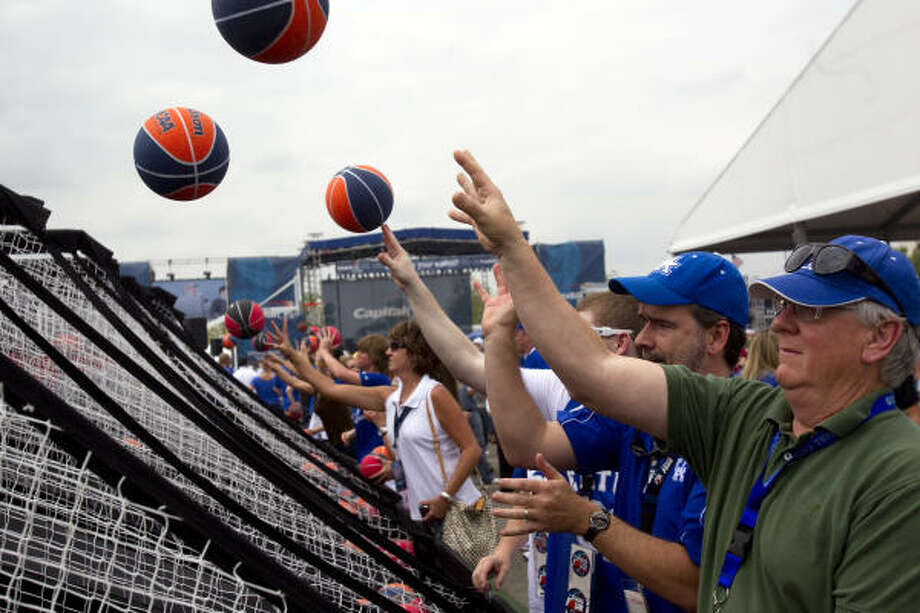 Fans play a basketball game at the NCAA Final Four Tip-Off Tailgate outside Reliant Stadium before the national semi-final games Saturday. Photo: Johnny Hanson, Houston Chronicle