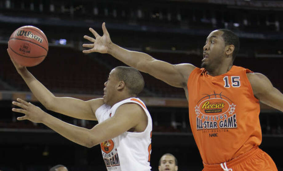 East guard Austin Freeman of Georgetown (15) defends against West guard Tristan Thompson of North Texas (20) during the first half of the Reese's College All-Star Game. Photo: Karen Warren, Houston Chronicle