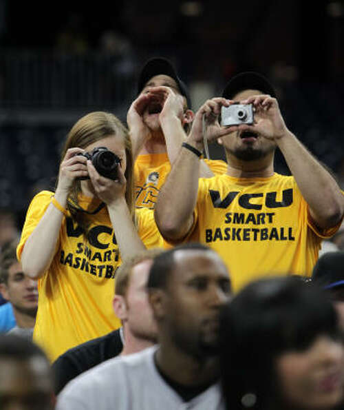 Virginia Commonwealth fans take photos during VCU's open practice at Reliant Stadium.