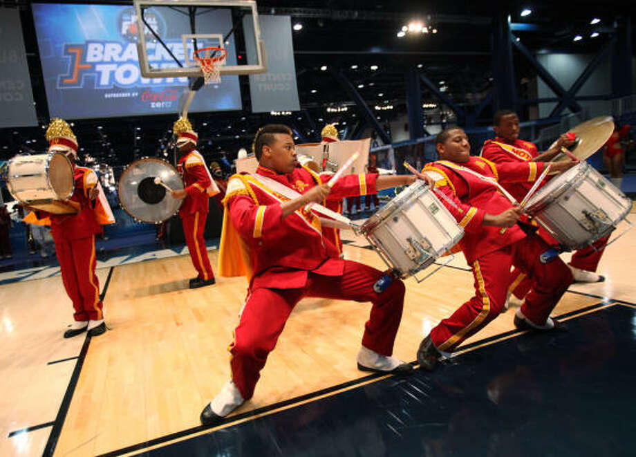 (Front, from left) Adrien Johnson, Larry Arion and Carven Hunter perform with The Marching Motion Band of Yates High School during the grand opening of Bracket Town on Thursday at the George R. Brown Convention Center. Photo: Mayra Beltran, Chronicle