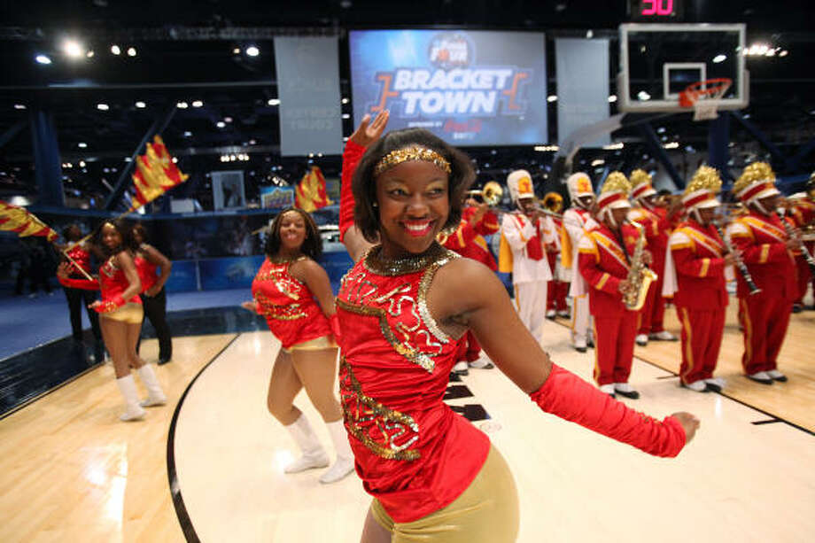 Lauren Hicks and the Yates High School dance team performs during the grand opening. Photo: Mayra Beltran, Chronicle