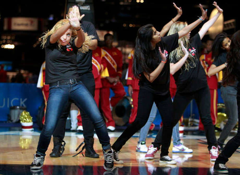 Lauren Palmarozzi, left, and the rest of the Bellaire EMOTIONS dance group perform during the grand opening. Photo: Mayra Beltran, Chronicle