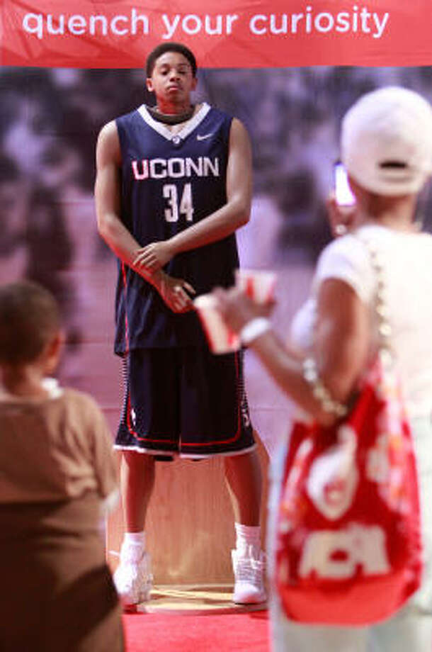 Norre Citizen, 11, of Houston, poses as a University of Connecticut basketball player in Bracket Town. Photo: Mayra Beltran, Chronicle