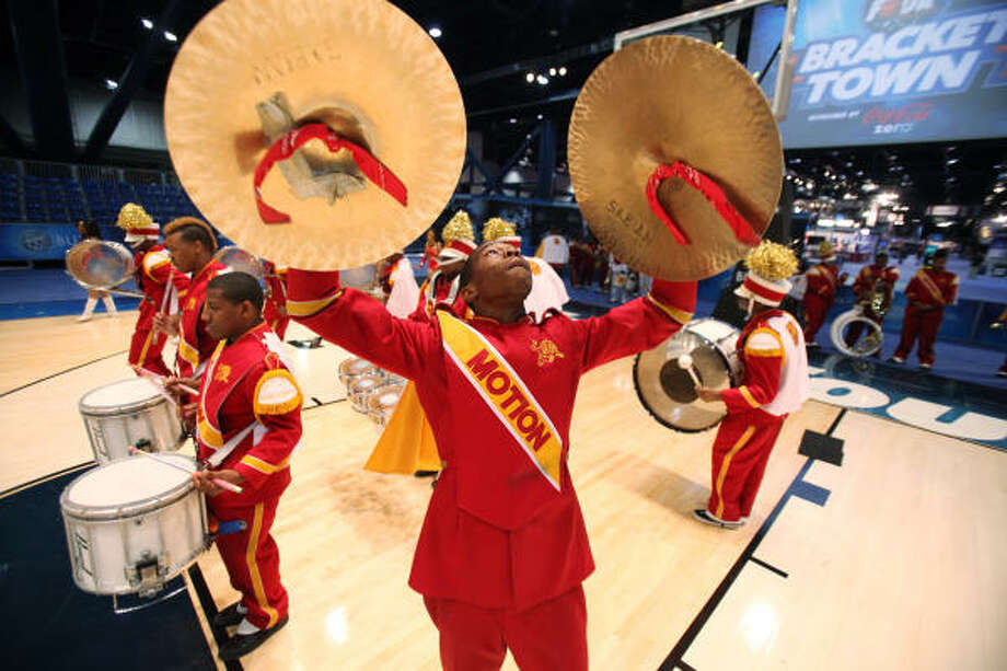 Carven Hunter plays the symbols as The Marching Motion band of Yates High School performs during the Grand Opening of Bracket Town at the George R. Brown Convention Center on Thursday, March 31, 2011, in Houston. Today is the celebrity HORSE competition, and everyday will have new family friendly activities during Final Four week. Photo: Mayra Beltran, Chronicle