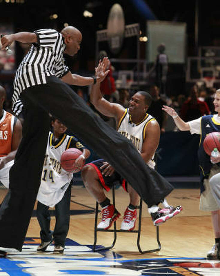 Ref. Leighton Condell greets Antonio Gates as he enters the court during the HORSE competition at Bracket Town at the George R. Brown Convention Center on Thursday, March 31, 2011, in Houston. Photo: Mayra Beltran, Chronicle