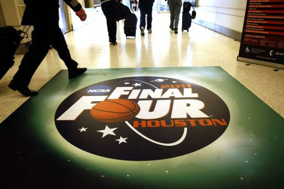 The NCAA Final Four logo is front and center as you exit the baggage claim area in Terminal B of Bush Intercontinental Airport as fans from the four teams competing in this weekend's NCAA Division l Championship Final Four began flying into Houston Thursday, March 31, 2011. Photo: Johnny Hanson, Houston Chronicle