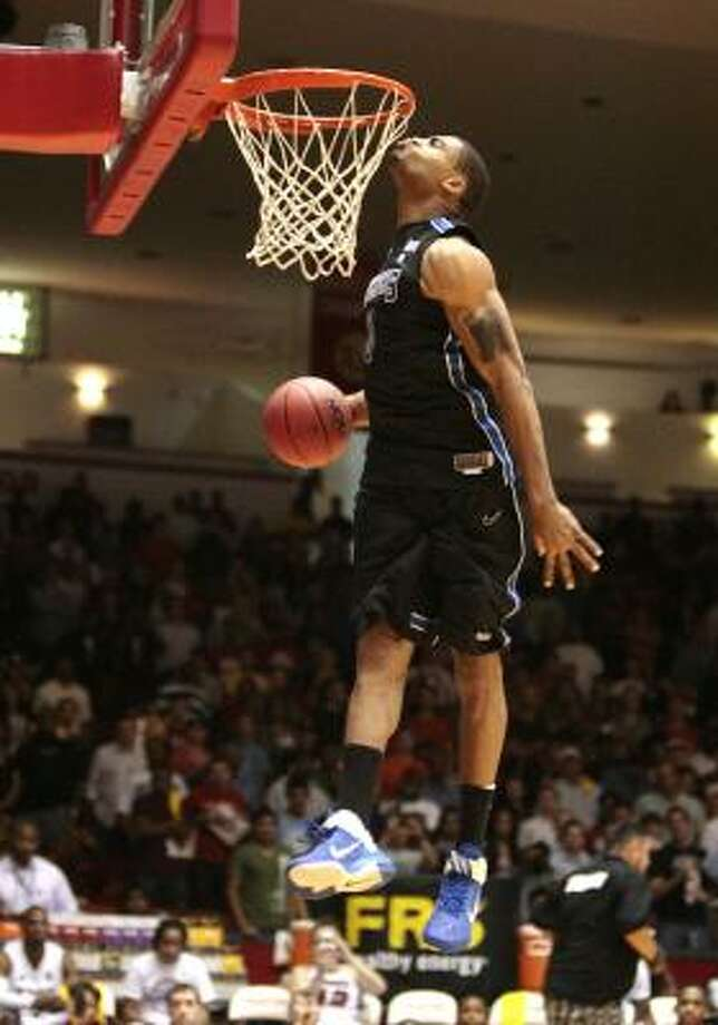 Will Coleman of the University of Memphis kisses the rim before finishing a dunk during  the State Farm College Slam Dunk Championships at the University of Houston's Hofheinz Pavilion, Thursday, March 31, 2011. Photo: Billy Smith II, Chronicle