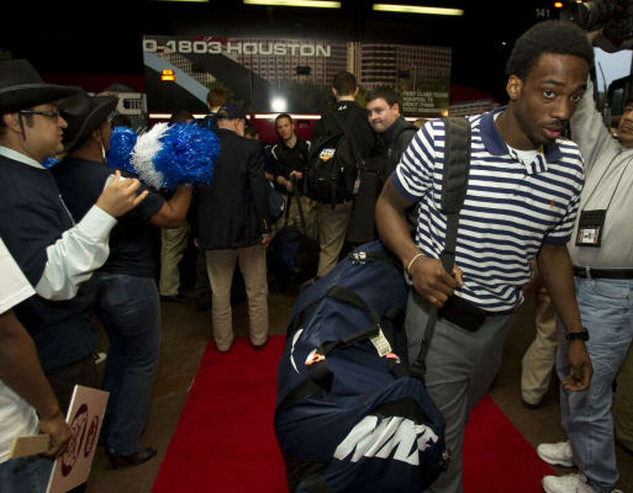 Butler guard Shawn Vanzant walks past a cheering section of Sheraton Suites employees as the Bulldogs arrive at the team's Galleria area hotel after arriving in Houston for the Final Four Wednesday, March 30, 2011, in Houston. Butler plays Virginia Commonwealth in the NCAA national semifinals on Saturday at Reliant Stadium. Photo: Brett Coomer, Houston Chronicle
