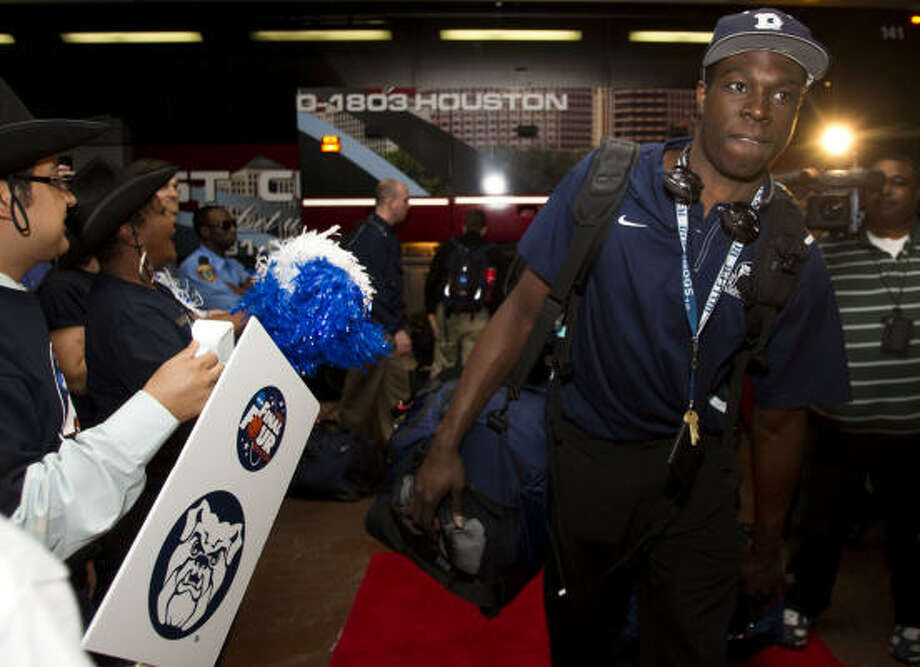 Butler forward Khyle Marshall walks past a cheering section of Sheraton Suites employees as the Bulldogs arrive at the team's Galleria area hotel after arriving in Houston for the Final Four Wednesday, March 30, 2011, in Houston. Butler plays Virginia Commonwealth in the NCAA national semifinals on Saturday at Reliant Stadium. Photo: Brett Coomer, Houston Chronicle