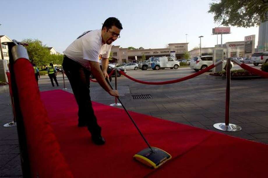 Ivo Pecheni, an employee at the Hotel Derek, cleans the red carpet before the arrival of Virginia Commonwealth University's (VCU) basketball team as the team is in Houston to compete in the NCAA Division l Championship Wednesday, March 30, 2011. VCU will play Butler Saturday, April 2. The winner of that game will play the winner of the Kentucky / University of Connecticut game for the national championship title. Photo: Johnny Hanson, Houston Chronicle