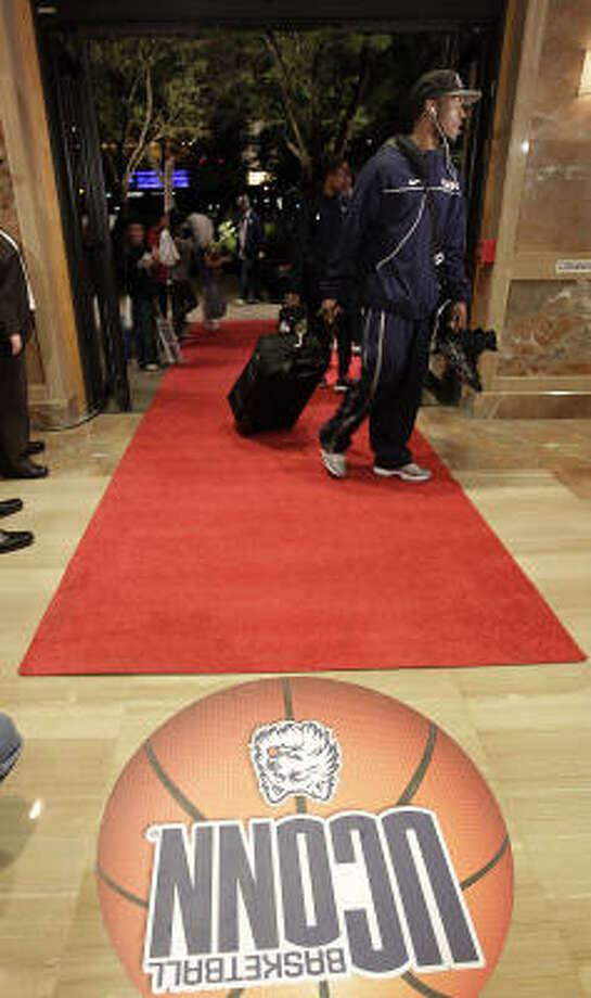 Connecticut Huskies guard Kemba Walker walks into the lobby of the JW Marriott in the Galleria, as he and the players of UConn arrive at their hotel, Wednesday, March 30, 2011, in Houston. Photo: Karen Warren, Houston Chronicle