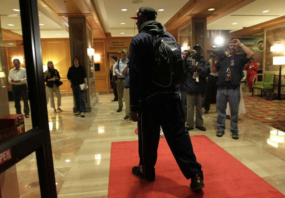 Connecticut Huskies forward/center Alex Oriakhi walks into the lobby of the JW Marriott in the Galleria, as he and the players of UConn arrive at their hotel, Wednesday, March 30, 2011, in Houston. Photo: Karen Warren, Houston Chronicle