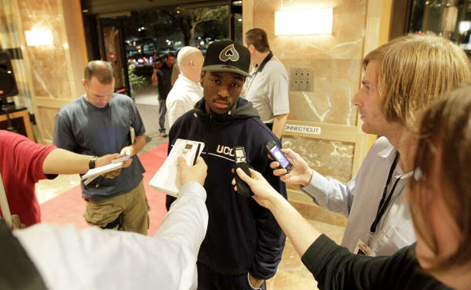 Connecticut Huskies guard Kemba Walker speaks to the media in the lobby of the JW Marriott in the Galleria, as he and the players of UConn arrive at their hotel, Wednesday, March 30, 2011, in Houston. Photo: Karen Warren, Houston Chronicle