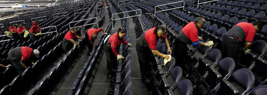 Workers line up in the lower section while cleaning off the seats at Reliant Stadium in preparation for the Final Four Tuesday, March 29, 2011, in Houston. Photo: Brett Coomer, Houston Chronicle