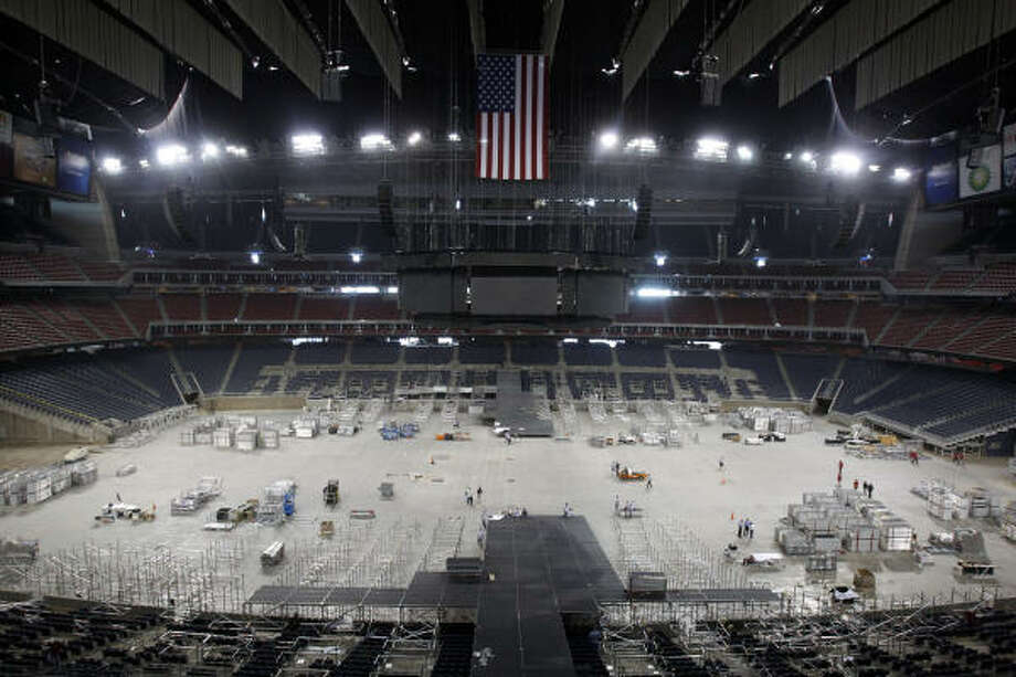 Workers are at Reliant Stadium working Tuesday, March 22, 2011, in Houston on the set-up for the basketball configuration in preparation of the 2011 NCAA Men's Final Four Championship. The seating riser platforms are being installed. Photo: Melissa Phillip, Houston Chronicle