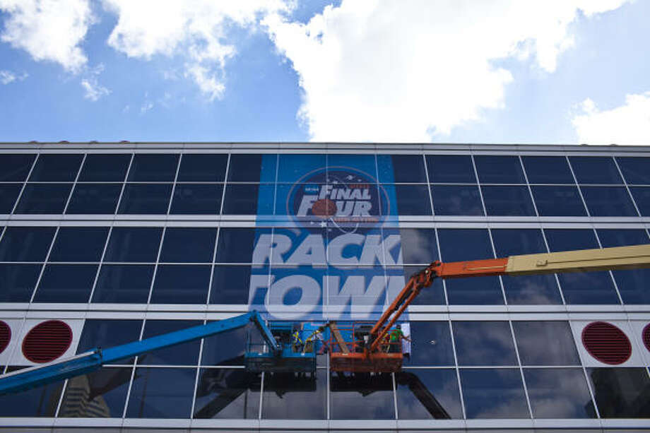 Workers install NCAA Final Four signage on the GRB March 21, 2011 in Houston, TX. Photo: Eric Kayne, For The Chronicle
