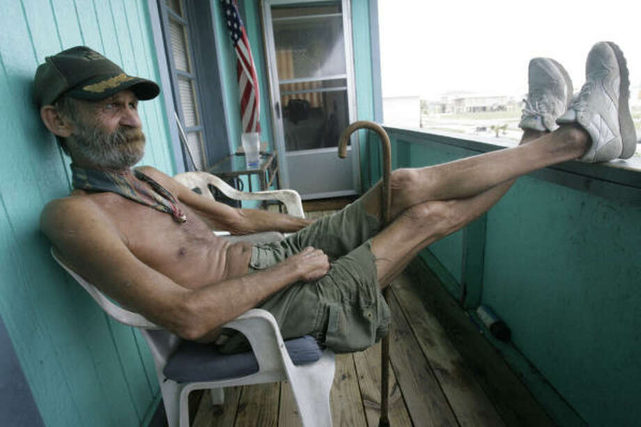 Ray Wilkinson, 67, of Surfside Beach, is seen on the chair where he rode out most of Hurricane Ike. Photo: Julio Cortez, Chronicle