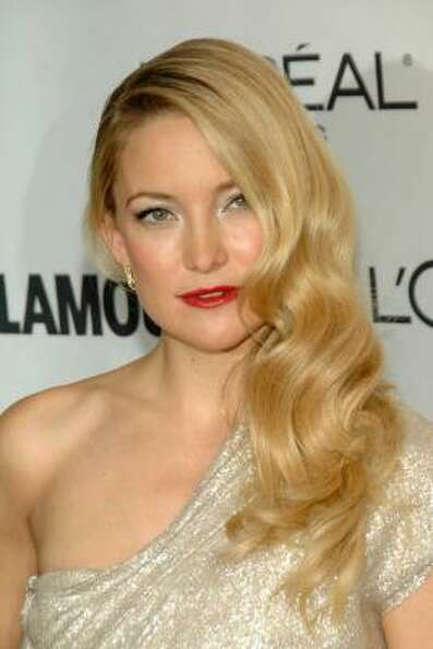 Kate Hudson had a toothache during a recent fashion shoot for Ann Taylor. She put on a brave face an