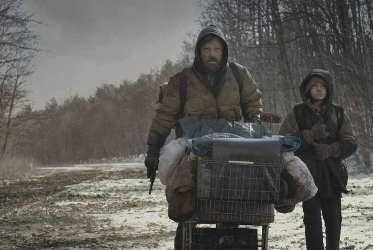 Cormac McCarthy's apocalyptic tale The Road will be released as a film starring Viggo Mortensen, left, and Kodi Smit-McPhee.