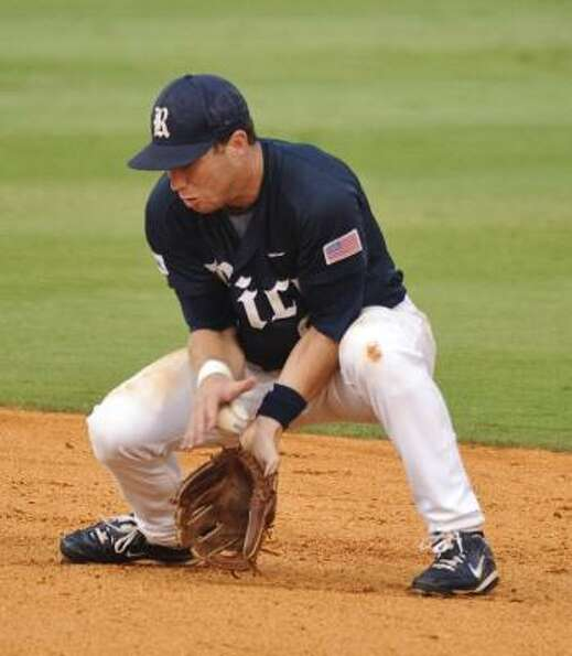 Rice second baseman Michael Ratterree mishandles a ground ball by California's Louie Lechich during