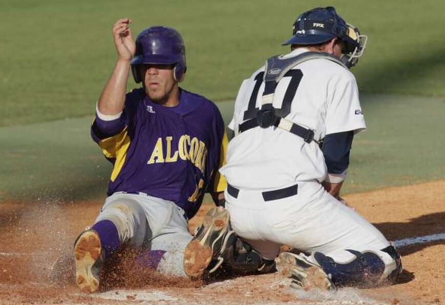Rice catcher Craig Manuel tags out Alcorn State's Edgardo Salas, left, in the third inning.