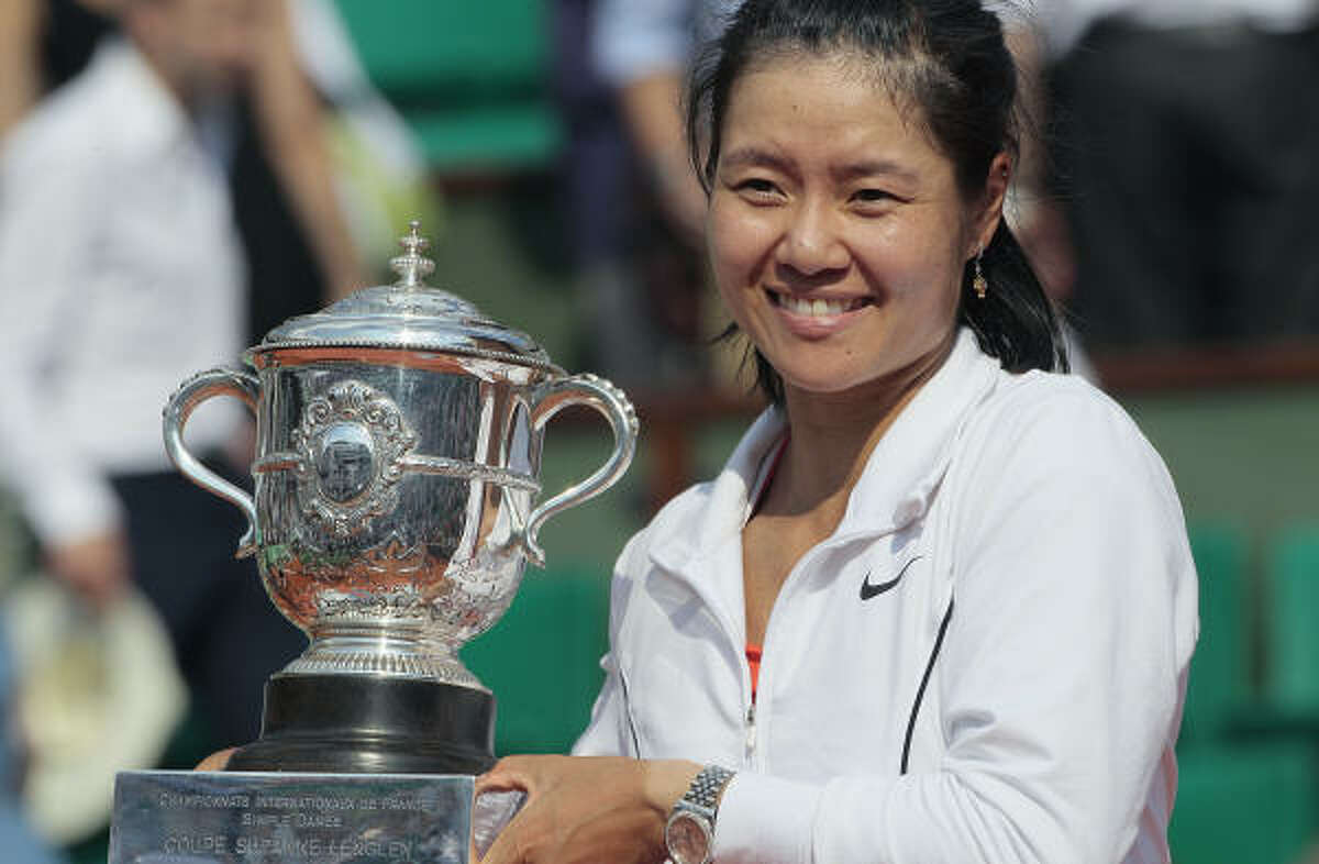 Li Na holds the trophy after winning the French Open final over Francesca Schiavone. Li becomes China's first grand slam champion.