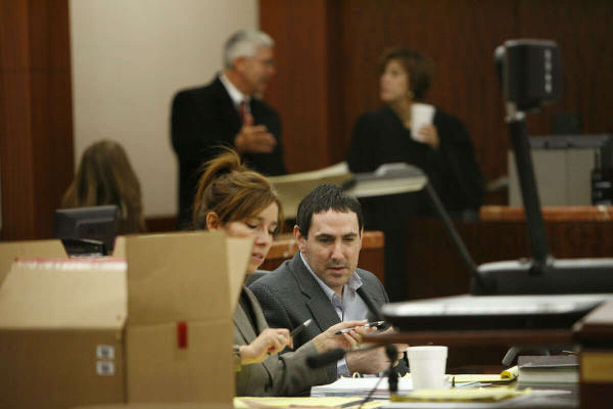 Steven Weinstein, shown in court with his attorney, Patty Segura, was convicted of murder in the death of a man whose body was found in the trunk of Weinstein's car.