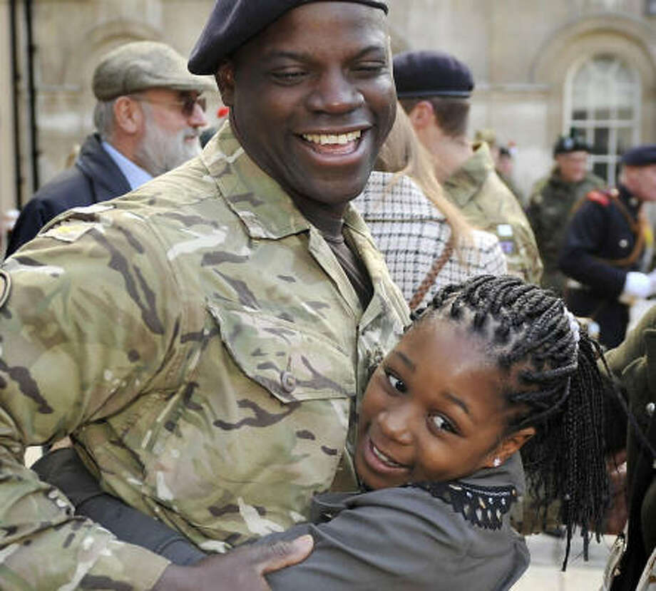 Who: Fussilier Michael Odesanya and his niece, Ashanti. Where:  London. When: Oct. 24, 2010.  Details They're at the homecoming parade for the London Regiment after a mission in Afghanistan. Photo: Tim Ireland, AP