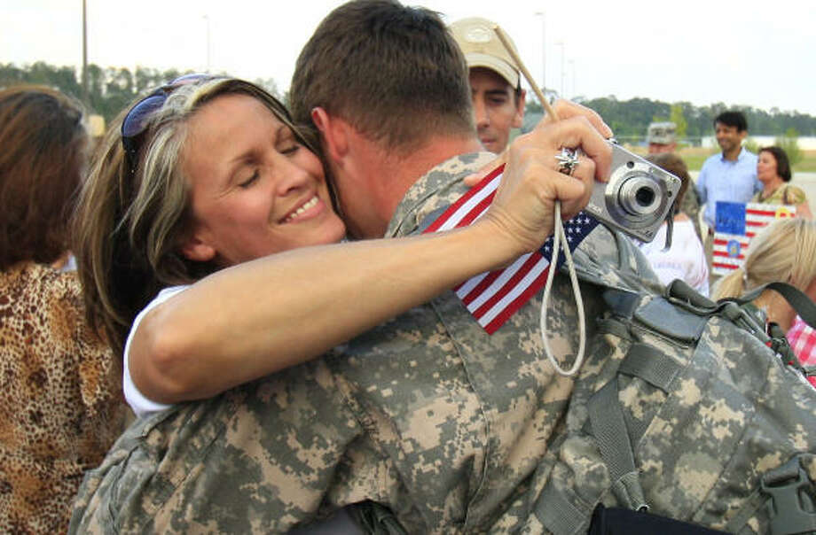 Who: Beth Devine and her son, Spc. Brett Pylant. Where:  Hammond, La.. When: May 12, 2010.  Details Pylant's unit, the 204th Airfield Operations Group, was in support of the missions in Iraq and Afghanistan. Photo: Derick Hingle, AP