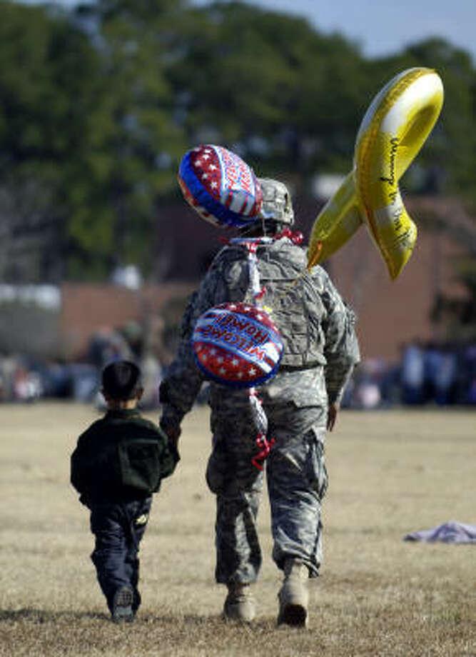 Who: Army Sgt. Penoga Unutoa . Where:  Fort Stewart, Ga. Where from:: Iraq. Mission: Training Iraqi police. When: Dec. 8, 2009. Photo: Stephen Morton, Getty Images