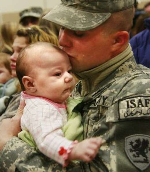 Who: Spc. Steve Metz and his daughter, 3-month-old Taylor. Where:
