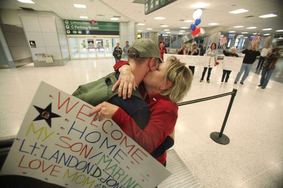 "Who: Marine Lt. Landon Jones and his mother, Vivian. Where:  Bush International Airport. When: Dec. 23, 2010.  Details:  ""It's always good to be in Texas"" Jones said after a seven-month tour. Photo: Mayra Beltran, Chronicle"