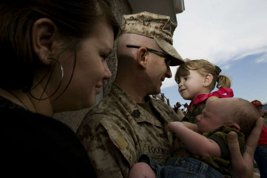 Gunnery Sgt. Matthew Lockwood is greeted by his wife, Shawna Lockwood, 26, daughter Abigail, 2, and his 6-week old son, Jackson, whom he met for the first time Monday. Photo: Johnny Hanson, Chronicle