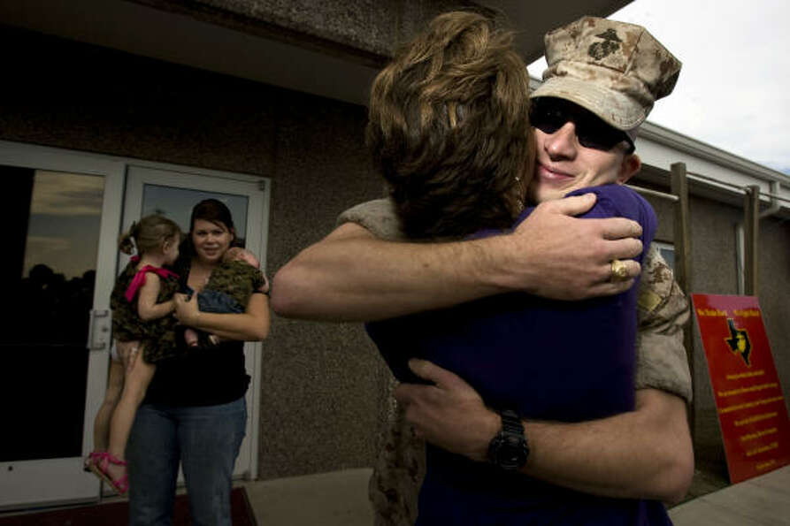 Gunnery Sgt. Matthew Lockwood is greeted by his mother, Michele Lockwood, as his wife, Shawna Lockwo