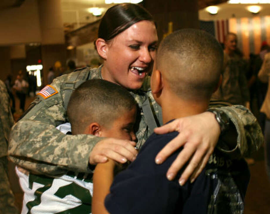 Who: Staff Sgt. Jennifer Word Where:  Fort Bliss When:  Nov. 12, 2007 Details:  She is welcomed home by her sons Adrian, left and Anthony. Her homecoming was a surprise for the boys. Photo: Victor Calzada, AP