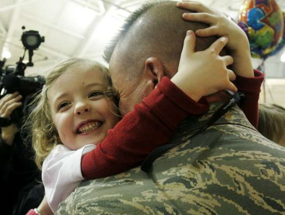 Who: Master Sgt. John Budenas Where: McGuire Air Force Base in New Jersey When:  March 24, 2008 Details:  He is greeted by his daughter, Haley Budenas, 4. Photo: Mike Derer, AP