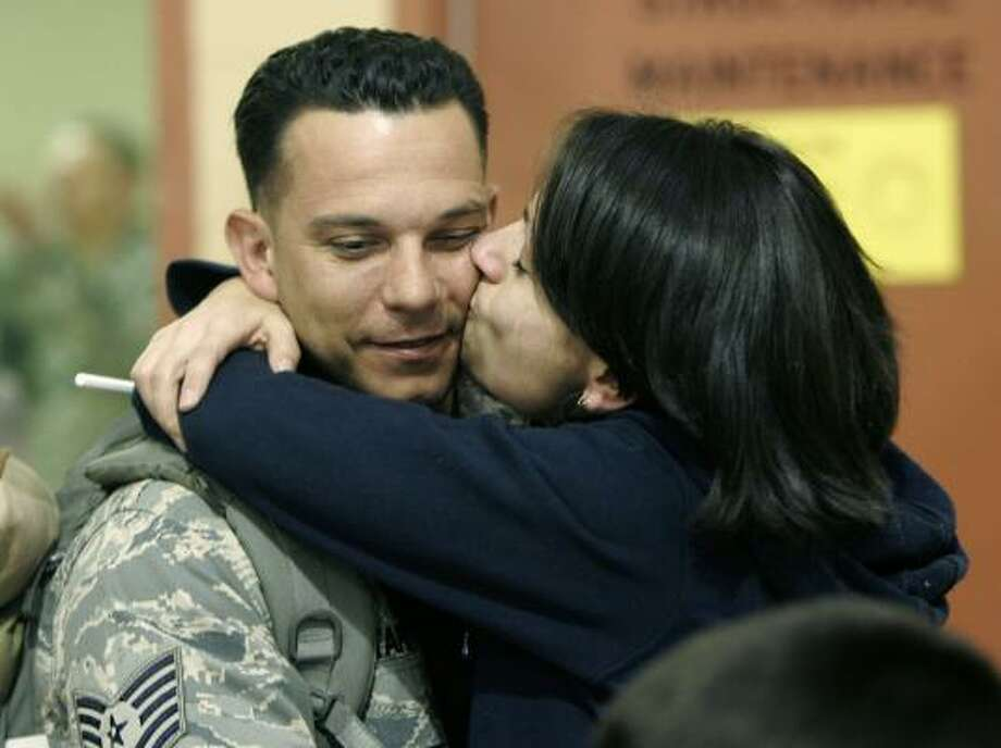 Who: Tech. Sgt. Santiago Tapia. Where:  McGuire Air Force Base in New Jersey When: March 24, 2008 Where from:  Iraq Details:  He is welcomed back by his wife, Paula. Photo: Mike Derer, AP
