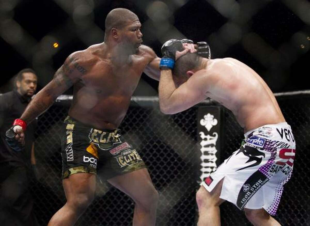 Quinton Jackson throws a series of punches against Matt Hamill in the third round.
