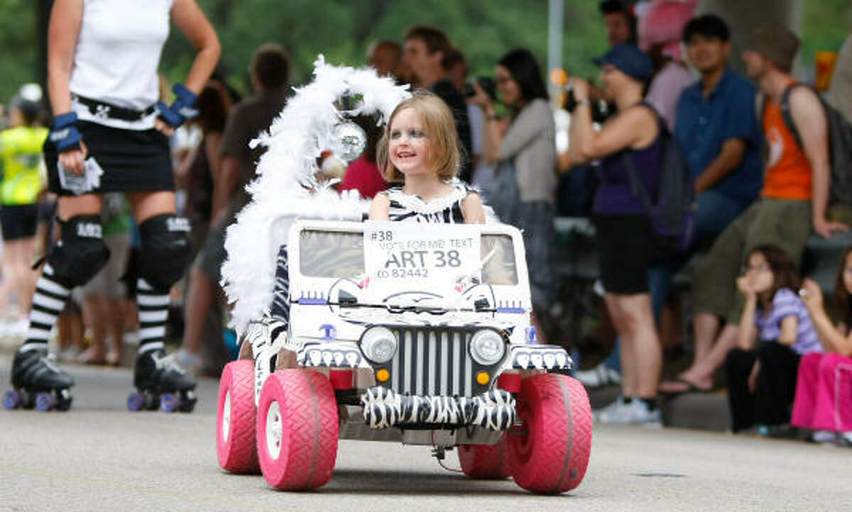 Who says kids can't have their own art car? Lea Lynch smiles at the crowd.