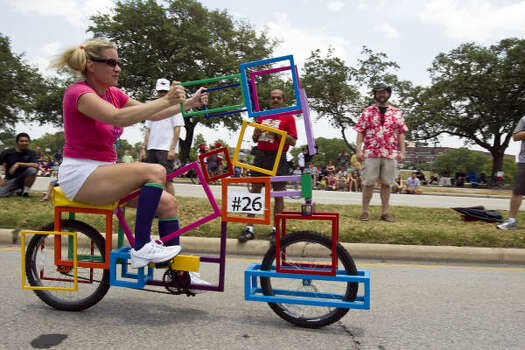 Jenn DiPrisco rides the Cube-a-cycle, made by artist Fredrick Stafford. Photo: Nick De La Torre, Chronicle