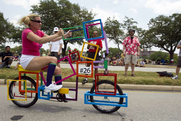 Jenn DiPrisco rides the Cube-a-cycle, made by artist Fredrick Stafford. Photo: Nick De La Torre, Chronicle / HC