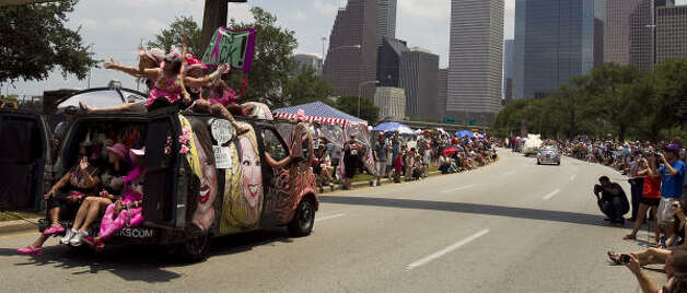 The women of the Survivors Rack art car wave to the crowd. Photo: Nick De La Torre, Chronicle / HC