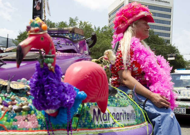 "Tonya Gerber sits on her and her husband's art car ""Margaritaville Jet Ski."" Photo: Nick De La Torre, Chronicle / HC"