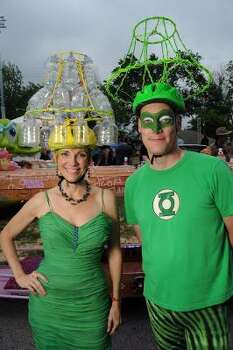 "Mary-Jane ""Chandelier"" Buschlen and Byron ""Green Lantern"" Norton attend Friday's Art Car Ball. Photo: Dave Rossman, For The Chronicle"