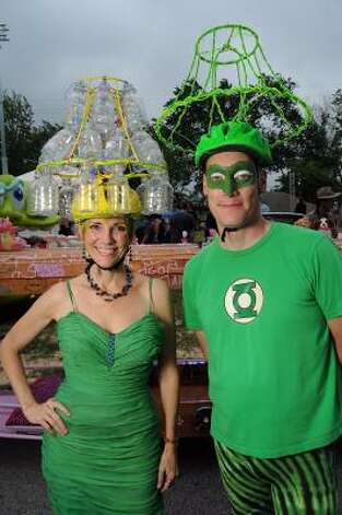 "Mary-Jane ""Chandelier"" Buschlen and Byron ""Green Lantern"" Norton attend Friday's Art Car Ball. Photo: Dave Rossman, For The Chronicle / HC"