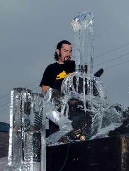 The Rev. Butter creates an ice sculpture for the Art Car Ball on Friday. Photo: Dave Rossman, For The Chronicle