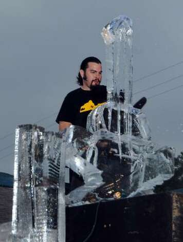 The Rev. Butter creates an ice sculpture for the Art Car Ball on Friday. Photo: Dave Rossman, For The Chronicle / HC