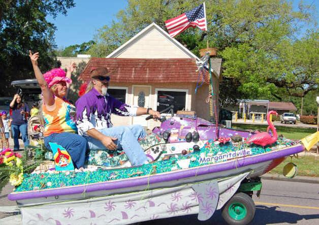 Dale and Tanya Gerber' s car Margaritaville, looks more like a boat on wheels than a car. Jimmy Buffet would be proud. Photo: Wendy Rudnicki, For The Chronicle / HC
