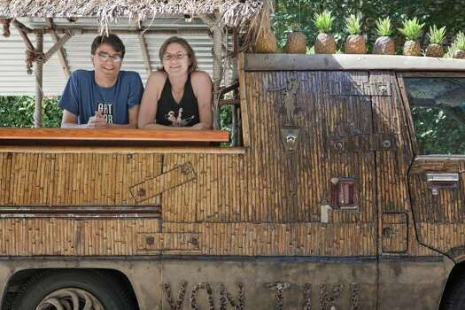 Amy Dinn and Jake Goldstein's art car is a tiki party on wheels. Photo: TODD SPOTH, For The Houston Chronicle